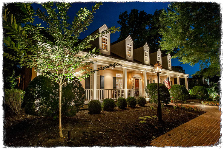 Home lit with landscape lighting.
